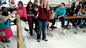 Oklahoma State Department of Education Science Director Tiffany Niell start the timer for a Gravity Vehicle trial run.